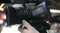 Videographer with a Camcorder at the Scene removes a Report at the Mall - stock footage
