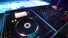 Disco dance floor with colorful lighting, disc jockey at the turntable. Stock Footage