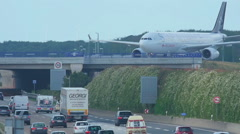 Airbus 330 over autobahn Stock Footage
