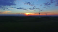 A stunning shot of a wind farm at dusk with a the last glimmers of daylight Stock Footage