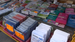 Cheap SIM cards for sale at a market in Hong Kong Stock Footage