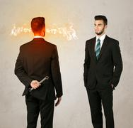 Angry businessman with weapon Stock Photos