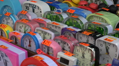 Colorful alarm clocks time counting market sale market Hong Kong Asia Stock Footage