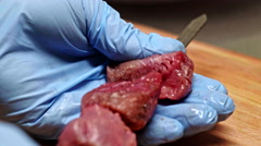 Stringing fresh meat on skewer. Close up Stock Footage