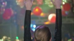 Back side of Dj girl in black top dance, raise hands at turntable in nightclub Stock Footage