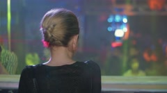 Back side of blonde Dj girl in black top dance at turntable in crowded nightclub Stock Footage