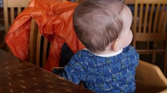 A boy sitting at restaurant table Stock Footage