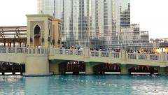 People crowd wait for Dubai Fountain show, stand at Burj Khalifa Lake bridge Stock Footage