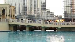 Audience at Burj Khalifa Lake bridge, against music fountain area, people Stock Footage