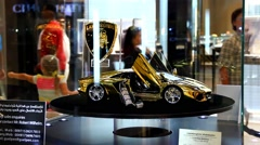 Gold scaled model of sport car, Lamborghini Aventador, at display in Dubai mall Stock Footage