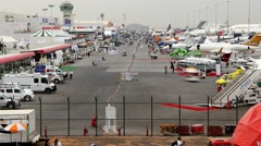Dubai Airshow 2013 static exposition, dusk fall, general aerial time lapse shot Stock Footage