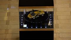 Gold Lamborghini Aventador scale model at exposition in mall, high angle Stock Footage
