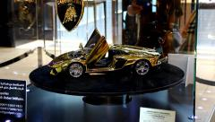 Golden Lamborghini Aventador scale model at exposition, made from pure gold Stock Footage