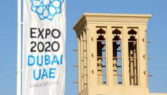 Expo 2020 Dubai UAE vertical banner flutter on wind, traditional windtower top Stock Footage