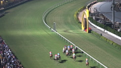 Professional jockeys take part in horse race contest in Hong Kong, Asia Stock Footage