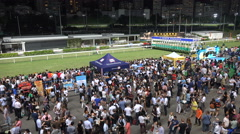 Audience awaiting the start of a horse race at racecourse in Hong Kong Stock Footage