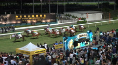 Cheering crowds at horse racing in Hong Kong, hippodrome, stadium, sports Stock Footage