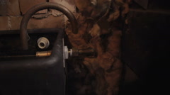 A male is fixing his central heating water tank in the attic Stock Footage