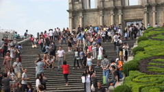 Crowds of tourists visit the ruins of St Paul's church in Macau Stock Footage