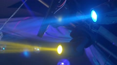 Yellow, green, blue beams from moving spotlights in nightclub Stock Footage