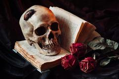 Gothic still life with skull - stock photo