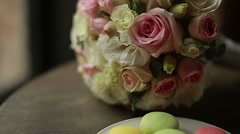 Close-up of  colorful macaron (macaroon) and a bridal bouquet Stock Footage