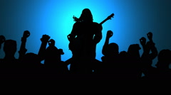 Rock guitar player and cheering crowd in sihouette Stock Footage
