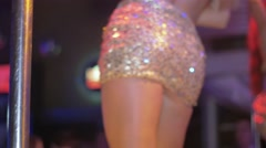 Sexy booty, legs of go go dancers in brilliant mini skirts on stage of nightclub - stock footage