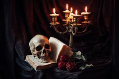 Stock Photo of Still life with skull, book and candlestick