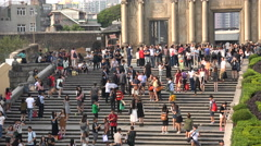 Tourists pose for pictures at St Paul's church in Macau Stock Footage