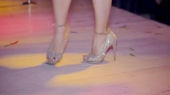 Dancing feet of go go dancer on high heels in nightclub. Red tippet. Slow motion - stock footage