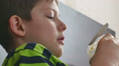 Boy teen jelly eating plastic cup Stock Footage