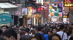 Chinese tourists visit popular shopping street, pastry shops, crowd, Macau Stock Footage