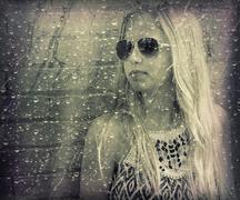 teenage girl behind wet window - stock illustration