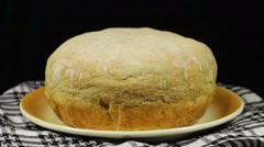 Homemade Bread on the Table Rotates on a Black Background Stock Footage