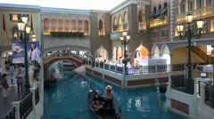 Chinese tourists take a gondola ride in the Venetian Macau Stock Footage