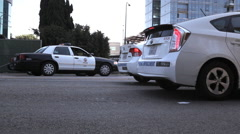Row of parking patrol enforcement cars and police car Stock Footage