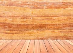 stone wall with wood floor in front off - stock photo