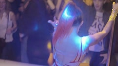 Back side of go go dancer in bikini with high ponytail in nightclub. Slow motion - stock footage