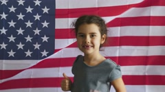 Teen boy shows gesture yes Independence Day American usa flag Fourth of July Stock Footage