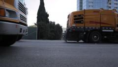 Urban street sweeper trucks driving Stock Footage