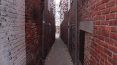 Woman walking down Snowflake alley in Annapolis, Maryland. - stock footage
