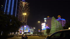 Taxis drive past one of the main casino strips in Macau Stock Footage