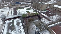 Quadrocopter shoot teaching, practice of emercom. Snow. Many people Stock Footage