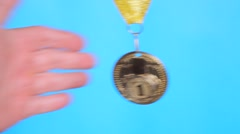 gold medal in hand - stock footage