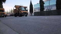 Row of municipal garbage trucks driving Stock Footage