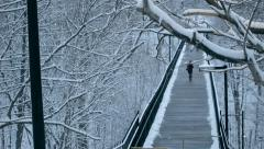 Pedestrian bridge covered in snow and ice during winter Stock Footage