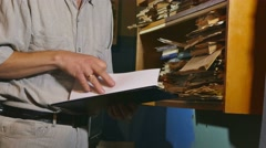 accounting clerk retro touches the paper old man in an old office - stock footage