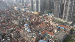 Changing urban China, traditional neighborhood, construction, new shopping plaza Stock Footage