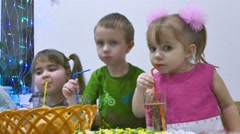 Children eat boy and girl family breakfast birthday eating christmas celebration Stock Footage